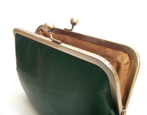 Image of Green leather shoulder bag with cross-body strap