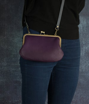 Image of Purple leather shoulder bag with cross-body strap