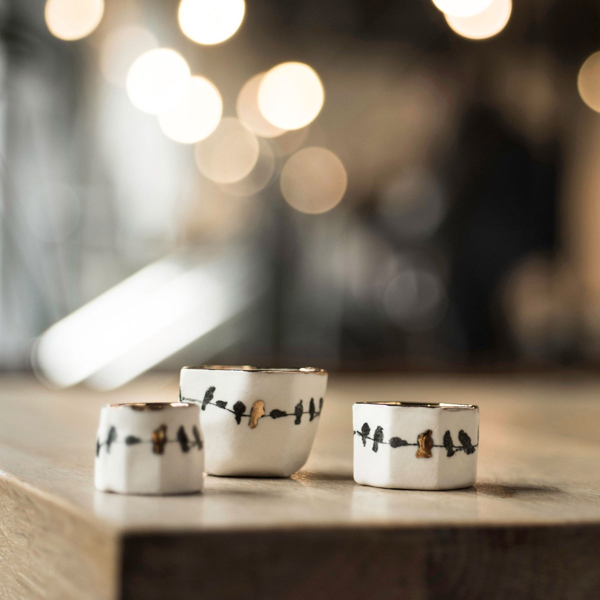 Porcelain birds on a wire ring pot