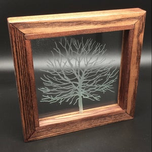 Image of Freestanding frame with tree design