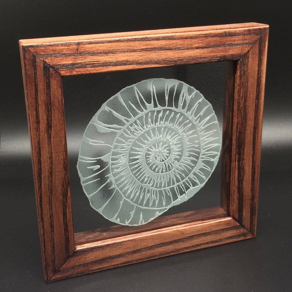 Image of Freestanding frame with ammonite design