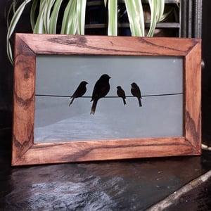 Image of Freestanding frame with birds design