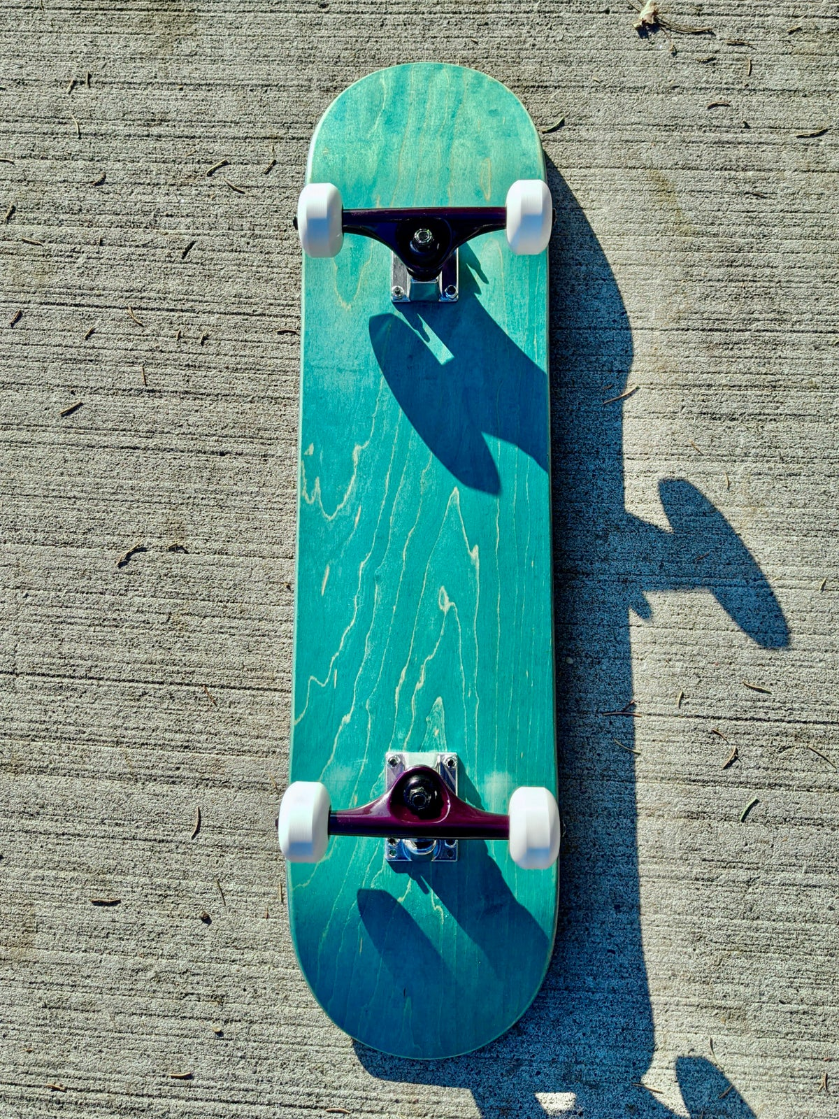 "Image of Turquoise 7.75"" Complete Skateboard"