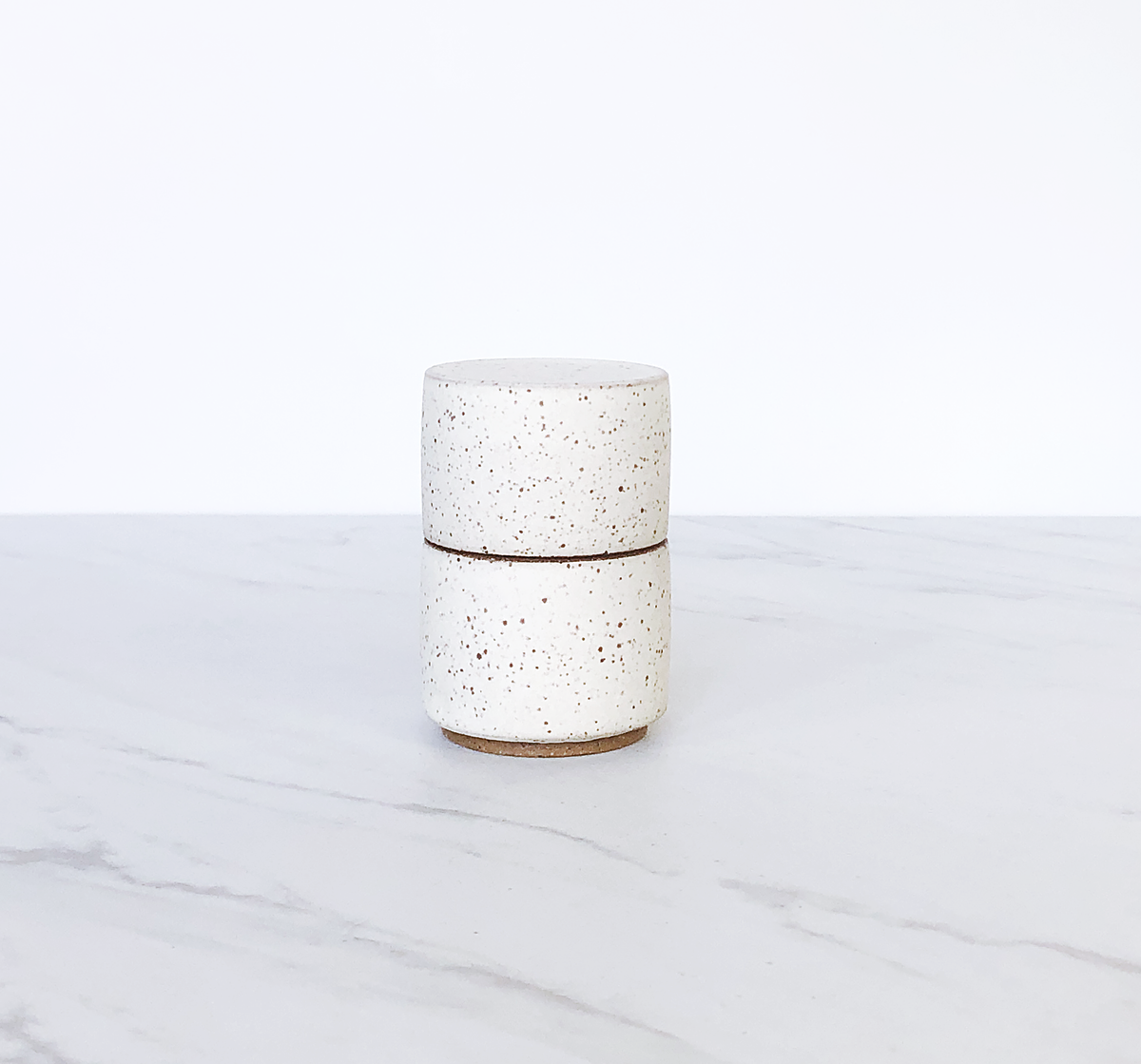 Image of Ceramic match holder with lid, glazed in matte cream