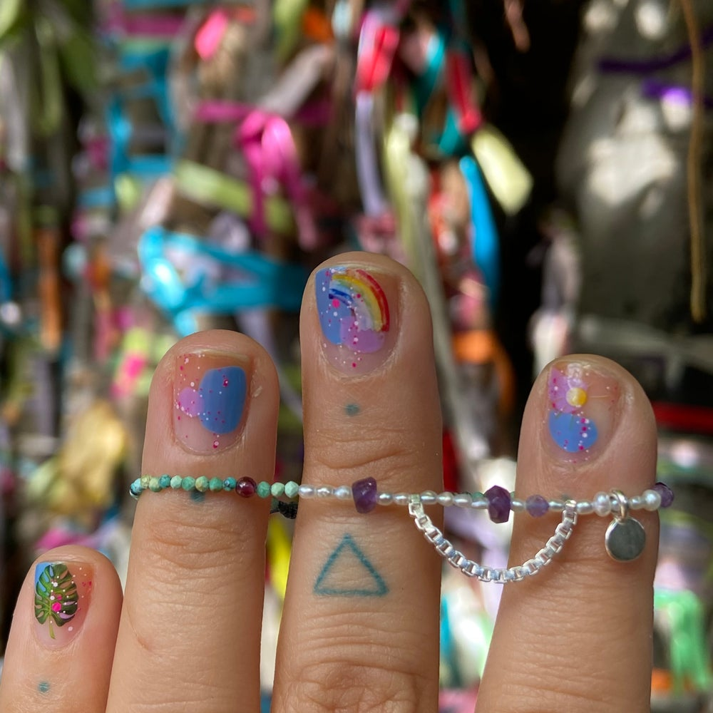 Image of tiny stones and charm bracelet