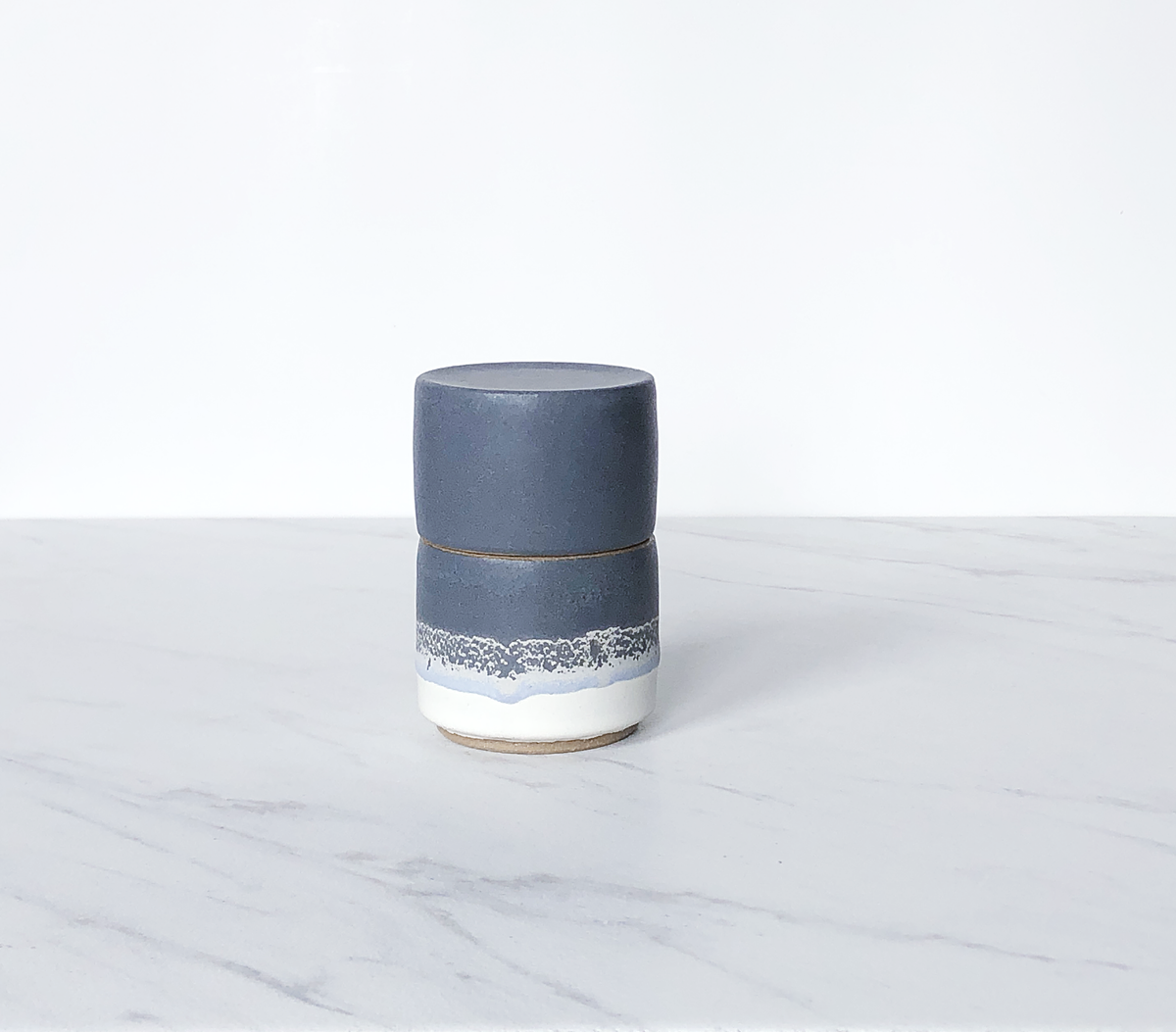 Image of Ceramic match holder with lid, tan clay, glazed in matte navy + cream