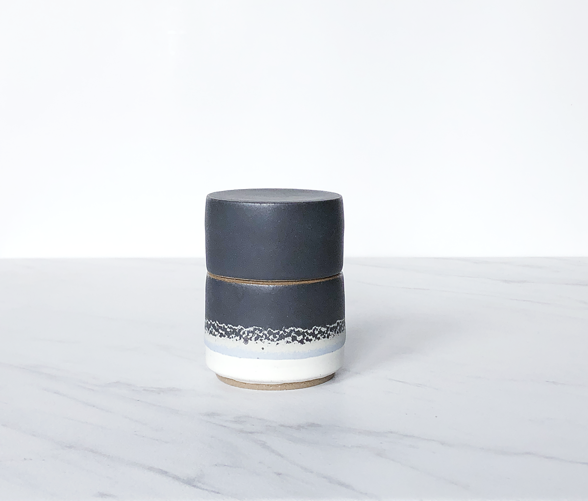Image of Ceramic match holder with lid, tan clay, glazed in matte charcoal + cream
