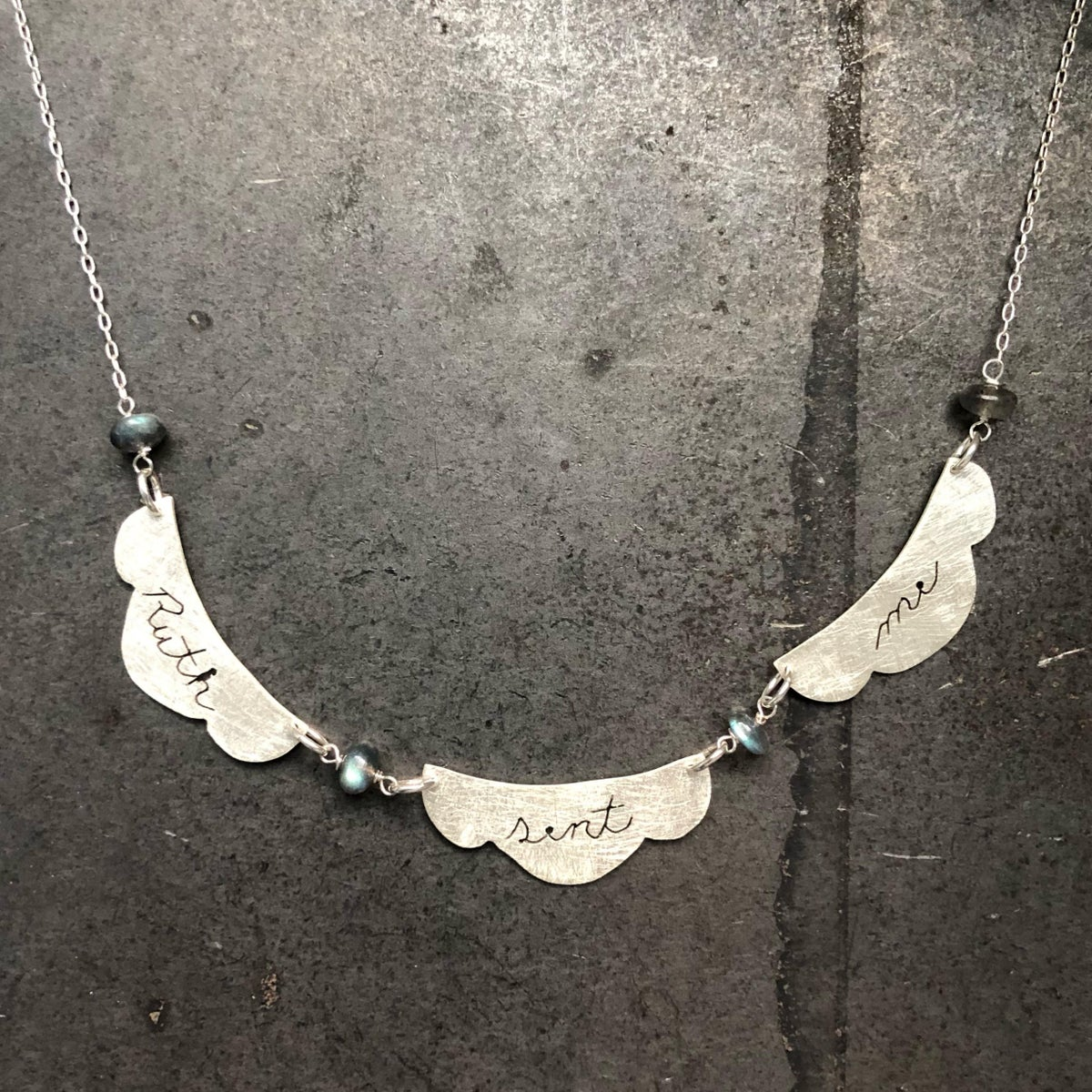 """Ruth sent me"" hand cut sterling silver RBG necklace"