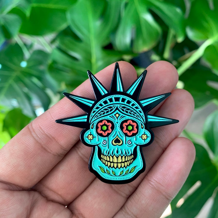 Image of STATUE OF MISERY (GLOW IN THE DARK PIN)