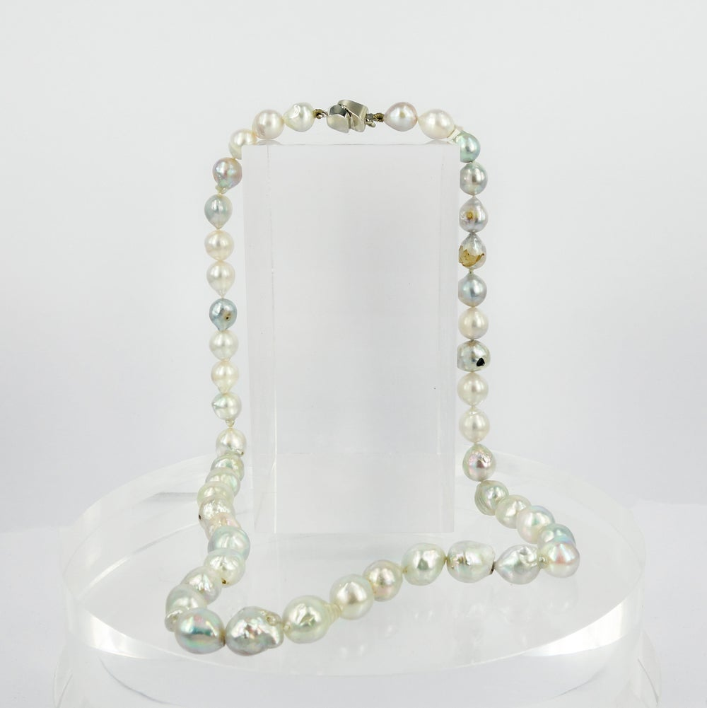 Image of Pearl strand with 14k white gold diamond set clasp. cp0274