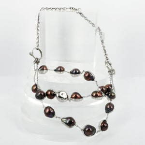 Image of Artisan sterling silver and black pearl necklace. Cp1070