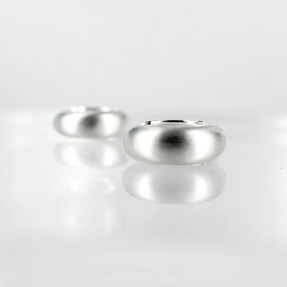 Image of Brushed sterling silver huggie hoop earrings. E1799