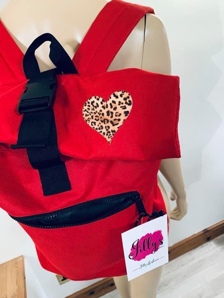 Rolo roll top rucksack with Harriet heart