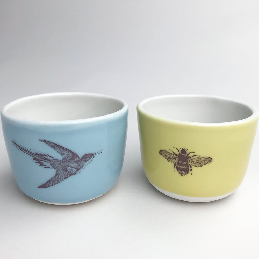 Image of set of two 8oz wee cups, with hummingbird and bumblebee