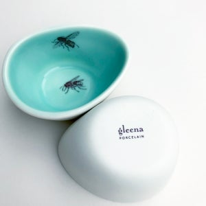 Image of pebble bowls, set of two, with chicken and bees,  aqua