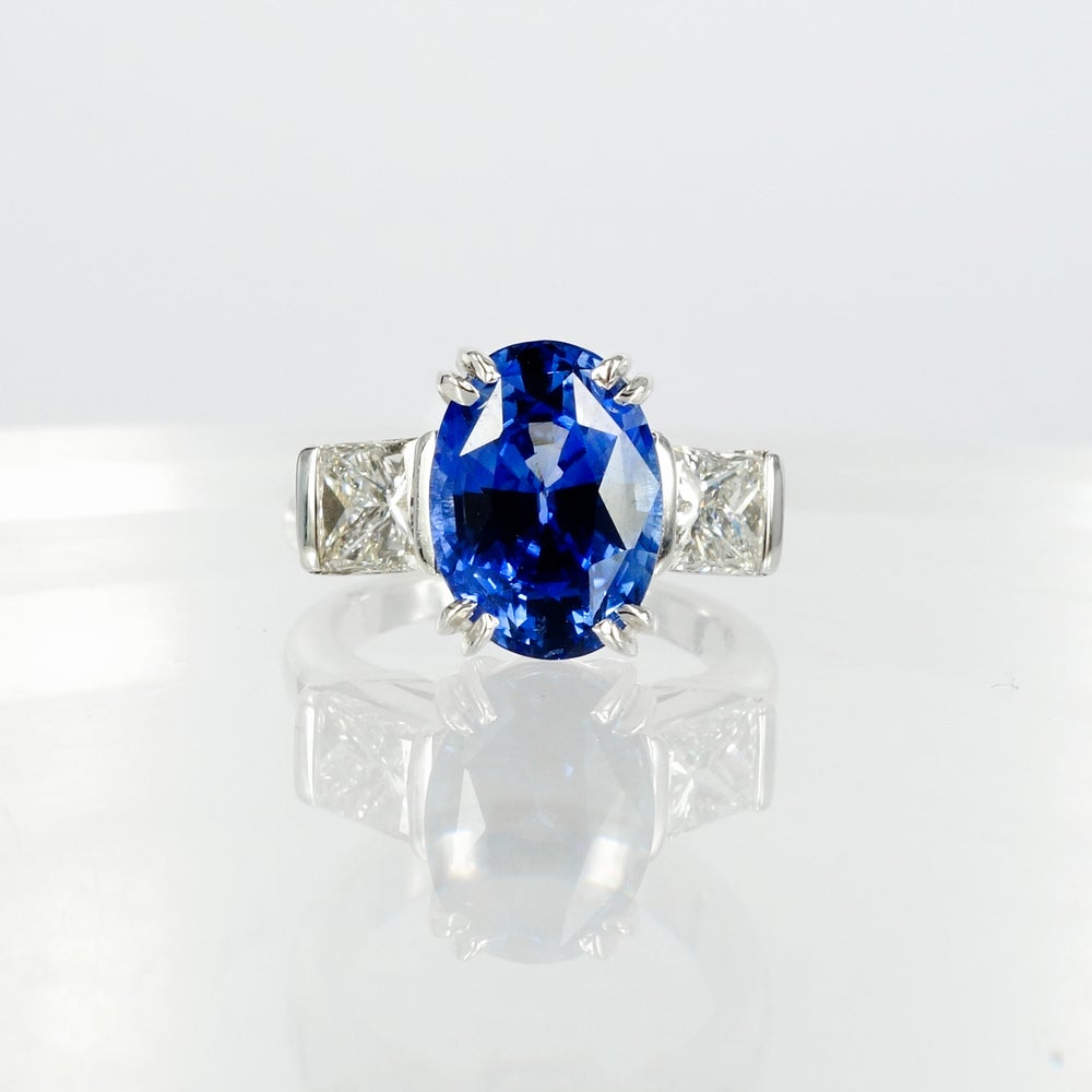 Image of 18ct white gold large oval Blue Sapphire trilogy ring . Sp2