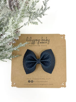 Image of Navy Herringbone Textured Faux Leather Ava Bow