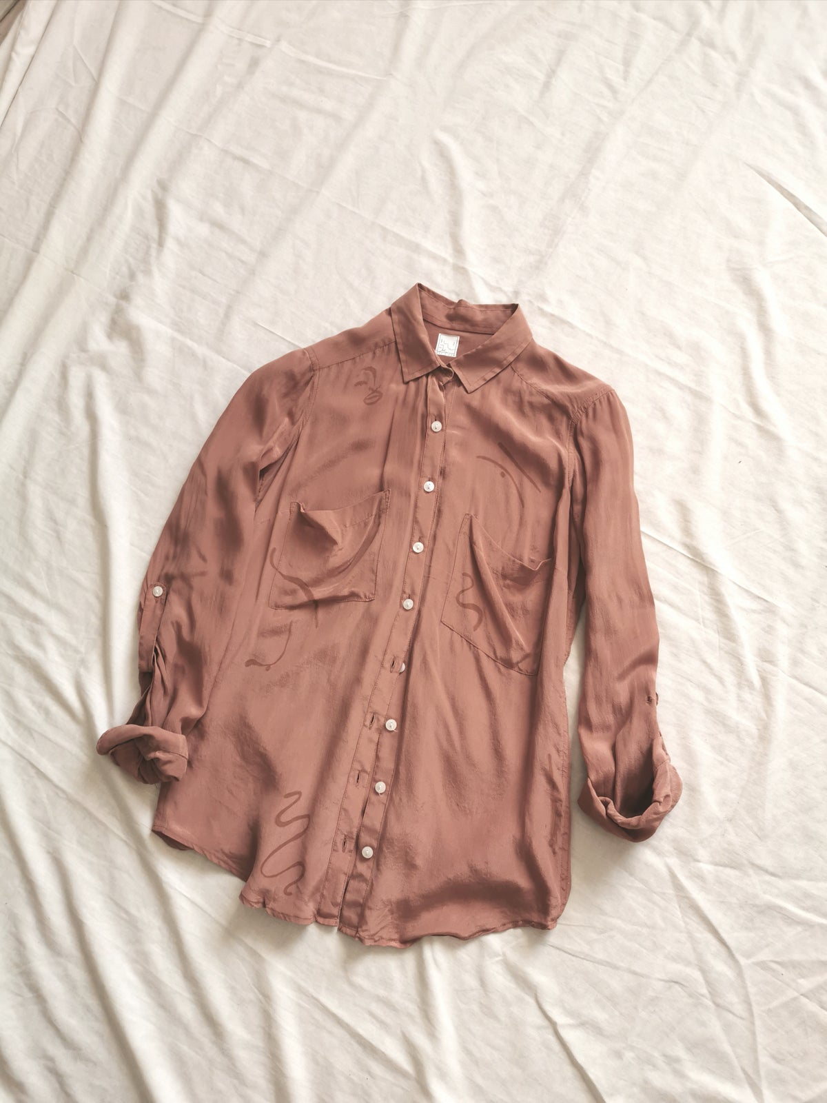 Image of papaya rust blouse