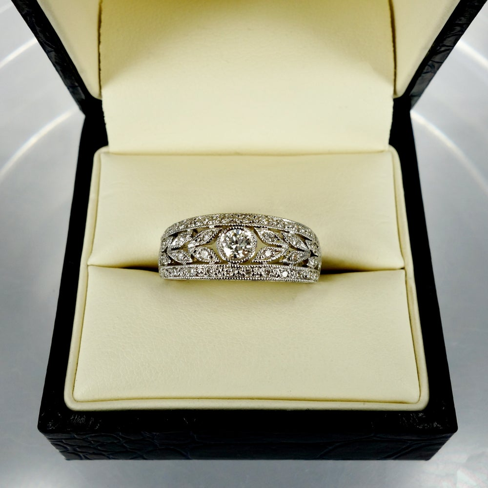 Image of 18ct white gold fancy antique style diamond set band. Sp8