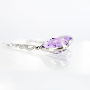 Image of Stunning platinum hand made diamond & Amethyst long drop earring.