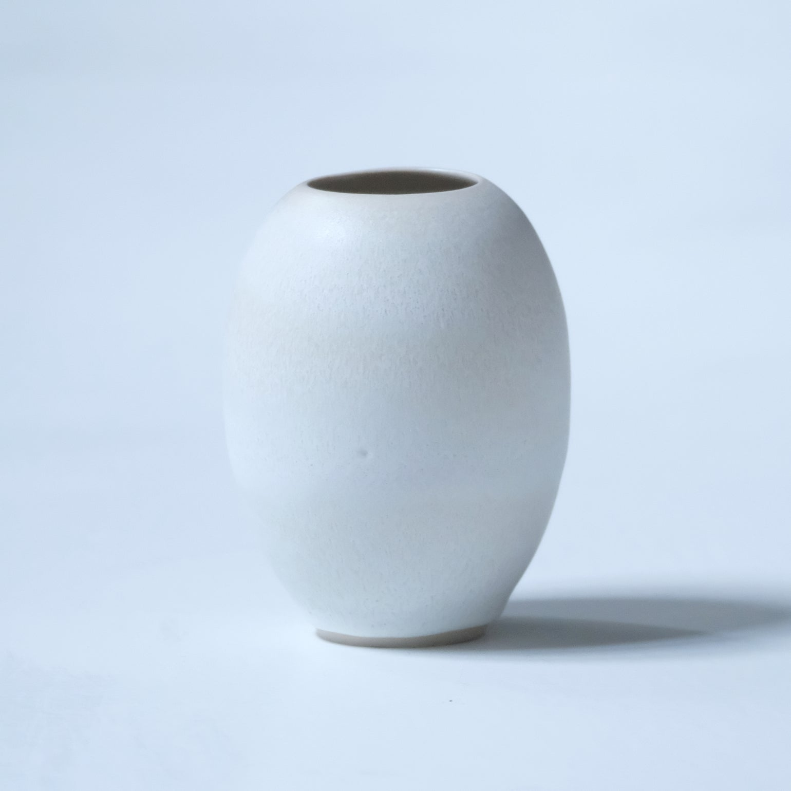 Image of SMALL OVAL SHAPED VASE IN FROSTED WHITE GLAZE