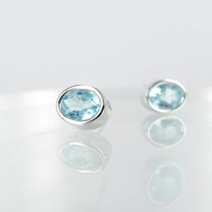 Image of Chic 14k white gold topaz stud earrings. M2134