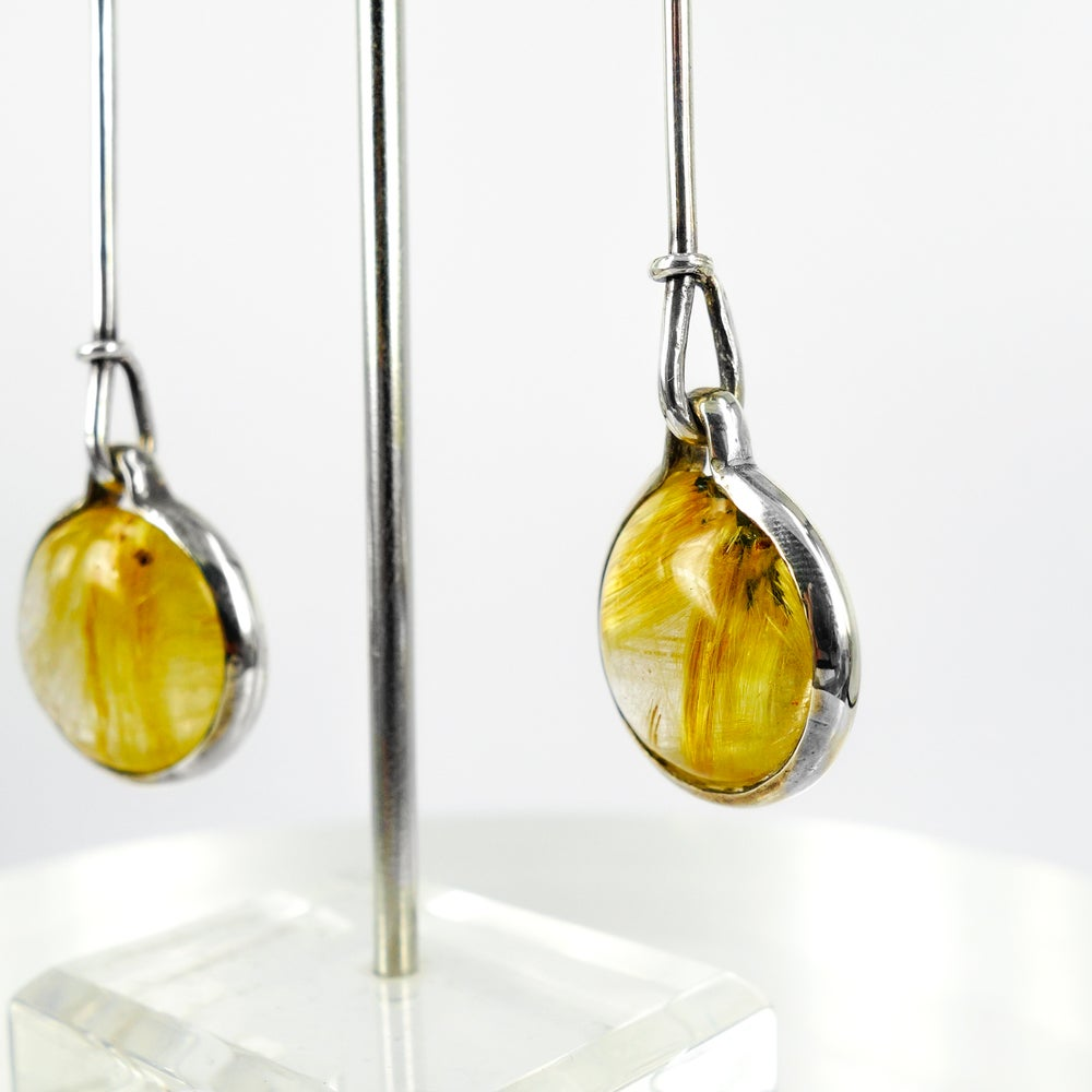 Image of Art nouveau rutilated quartz sterling silver drop earrings. M2991