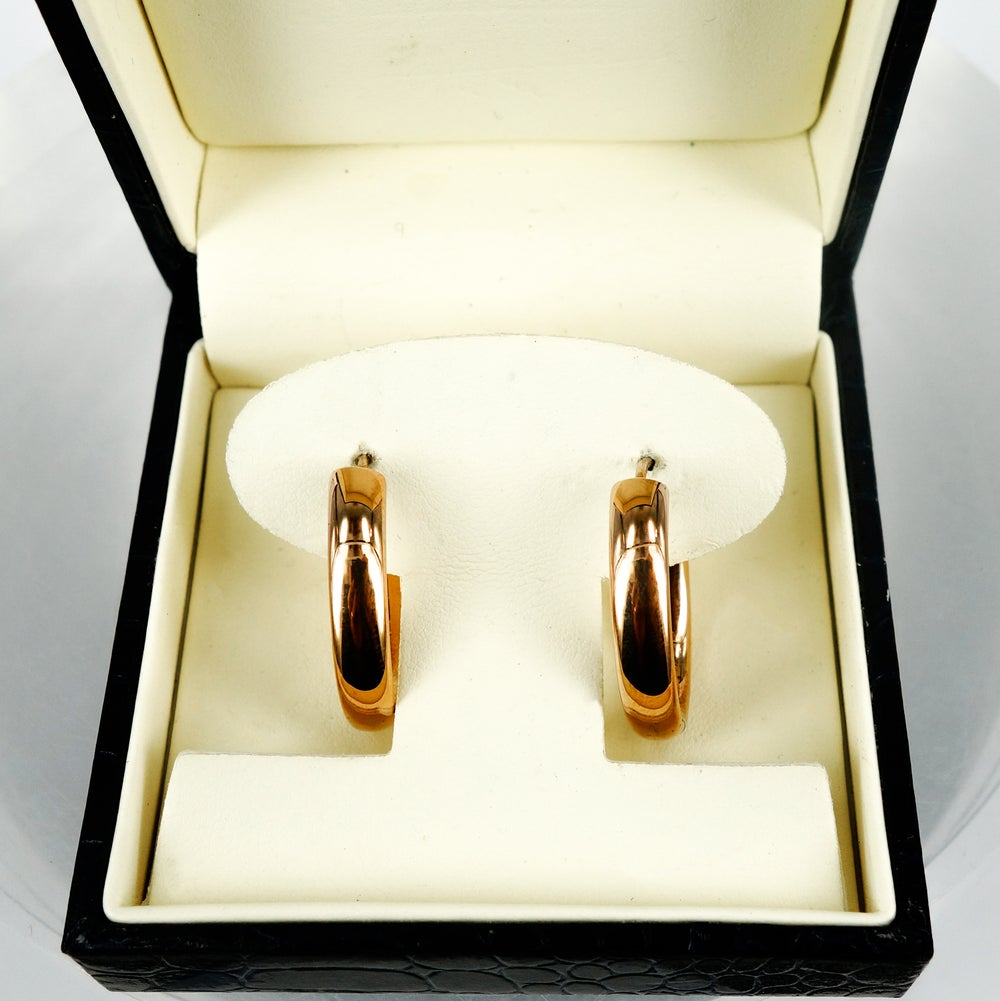 Image of Rose gold plated hollow oval hoop earrings. M3006