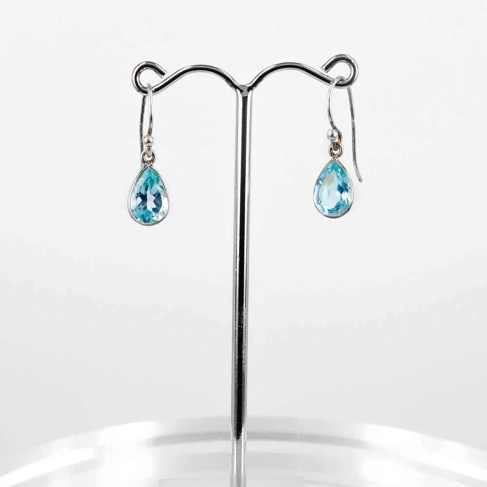Image of Sterling silver blue topaz drop earrings. M3045