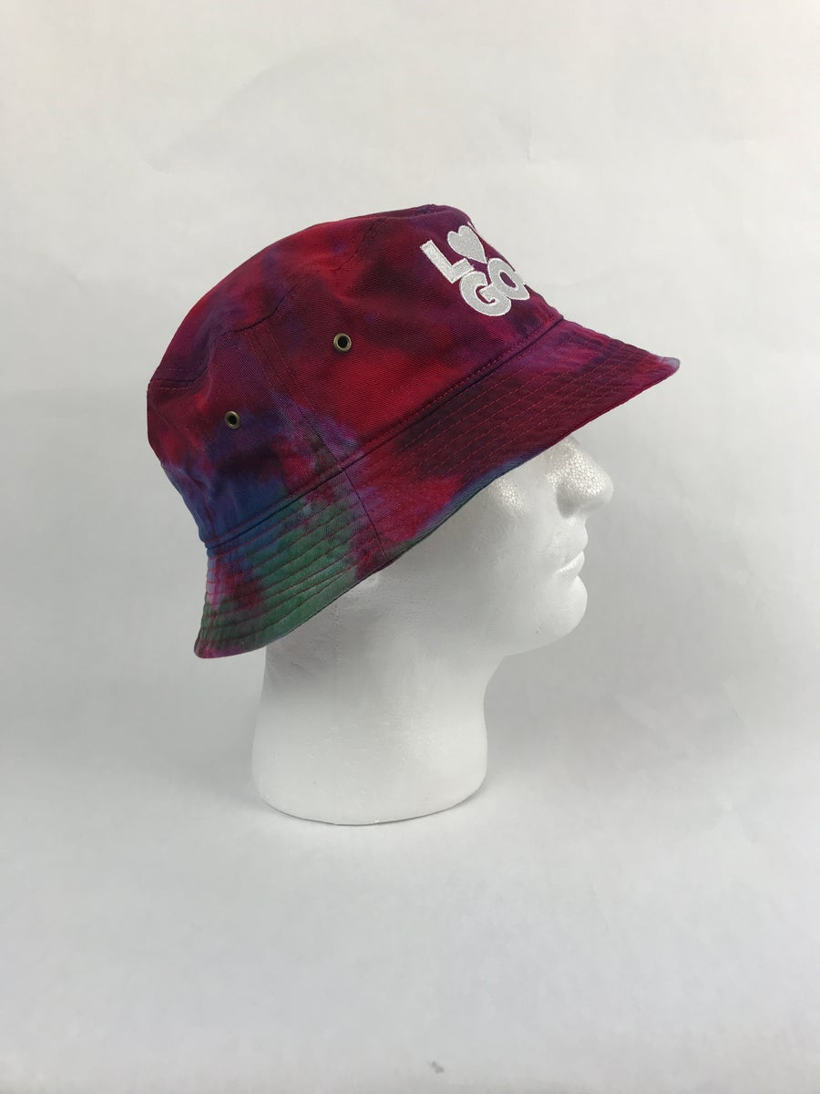 Image of Red tie dyed LDCGG BUCKET HAT