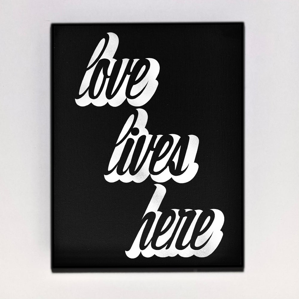 """Love Lives Here"" Canvas"