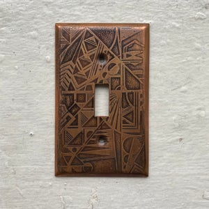 Image of etched copper light switch plate