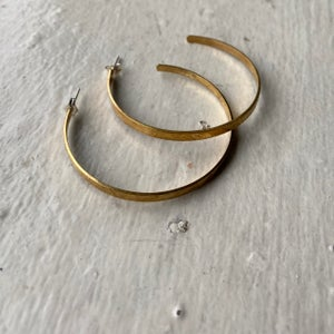 Image of large etched brass hoops