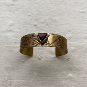 Image of small etched brass cuff with jasper stone