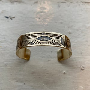 Image of small etched brass cuff I