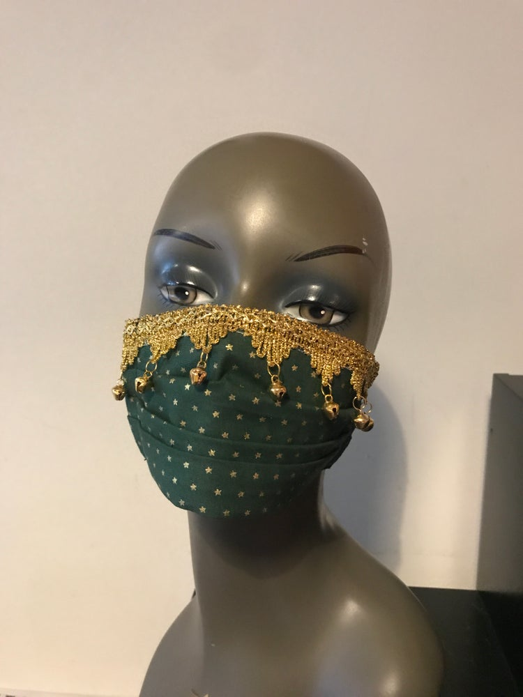 Image of Gold stars with bells on face mask