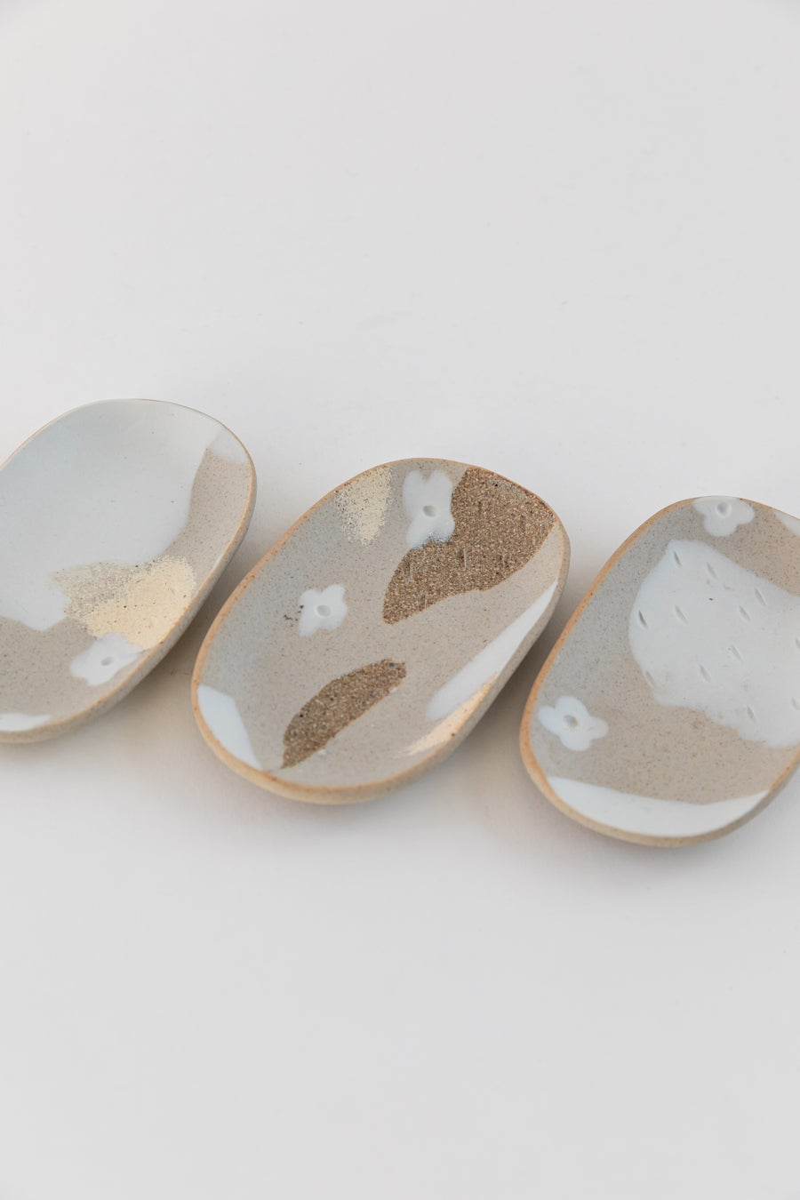 Image of Small Oval Jewelry Dish - Beige with white flowers