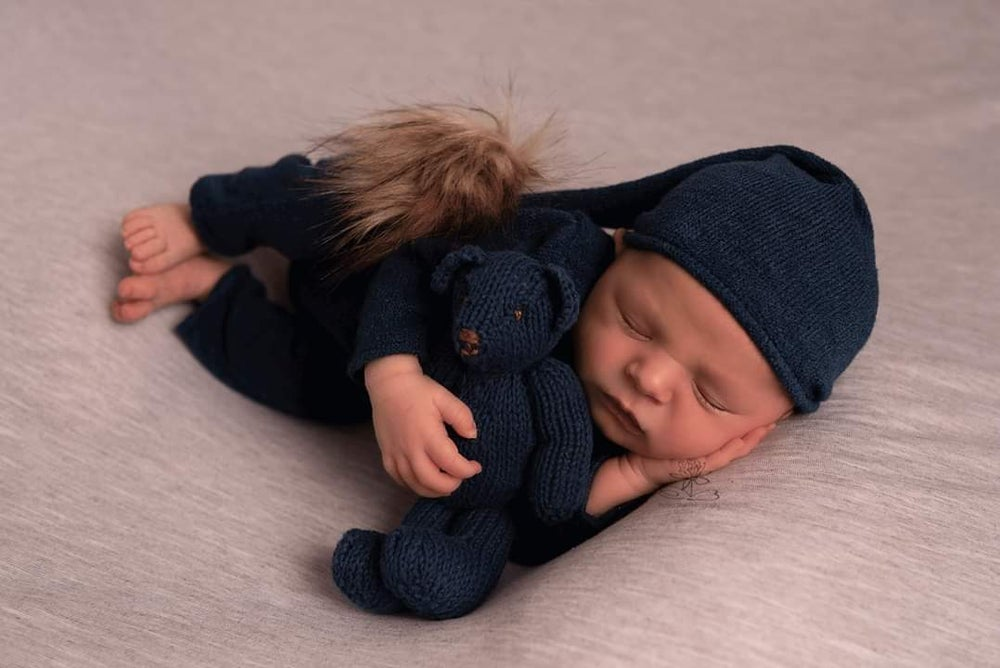 Image of Footless  newborn pyjamas with a sleep hat . Ready to post