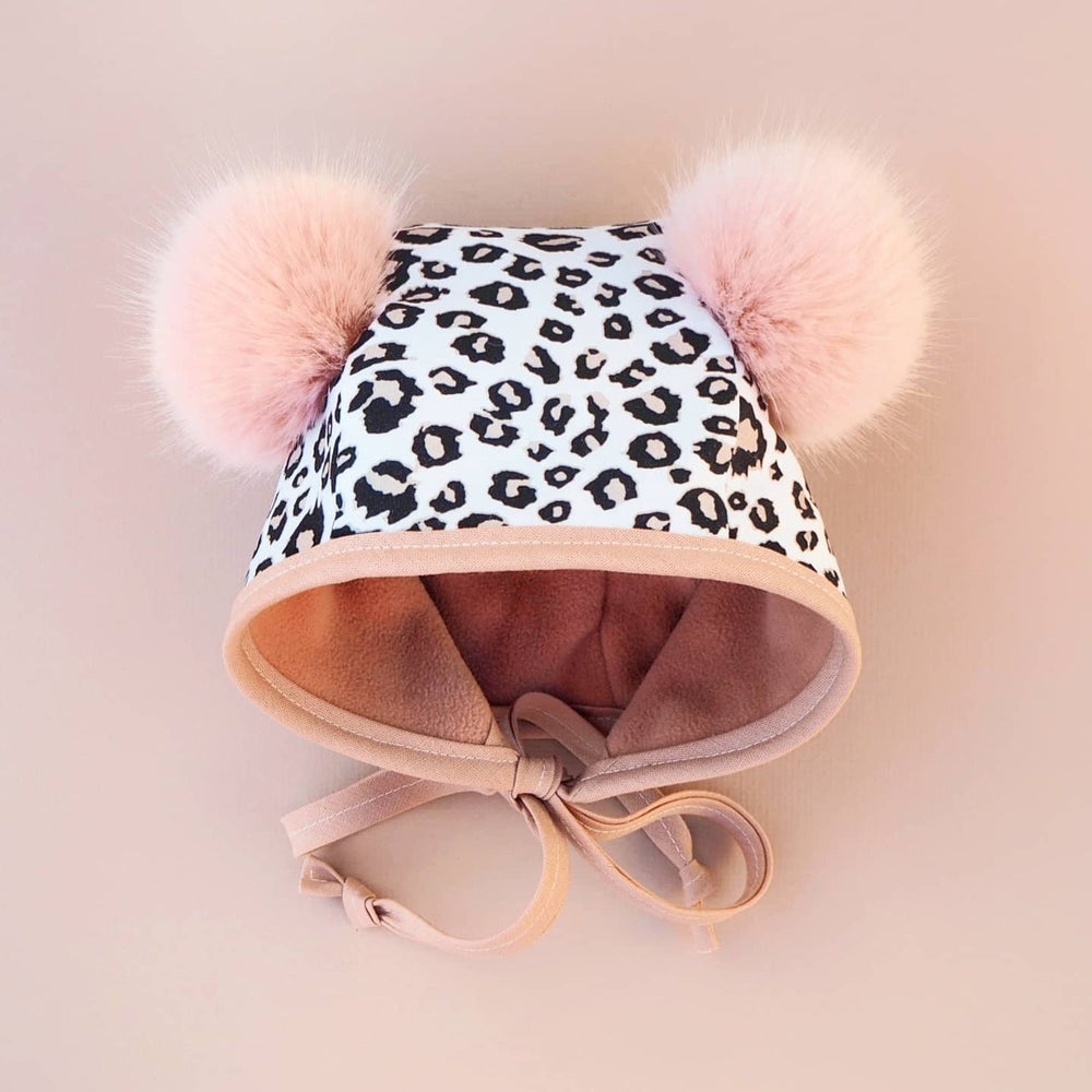 Image of Snow Leopard pom pom bonnet
