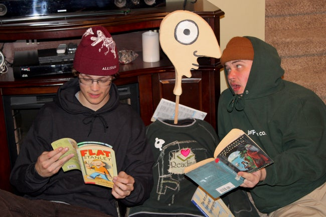Jorp and two other individuals reading their favorite books