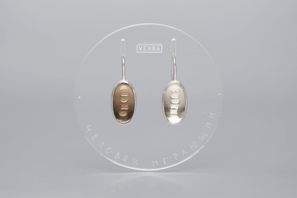 """Image of """"Man the player"""" silver earrings with rock crystal and smoky quartz · HOMO LUDENS ·"""