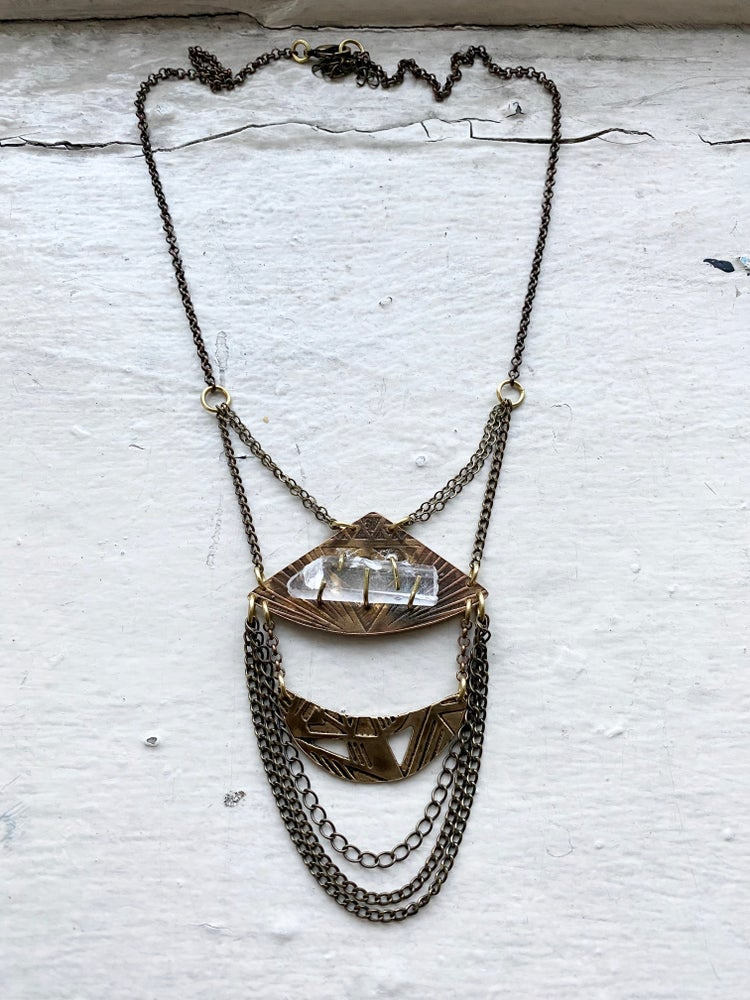 Image of two tiered pendant with prong set quartz crystal