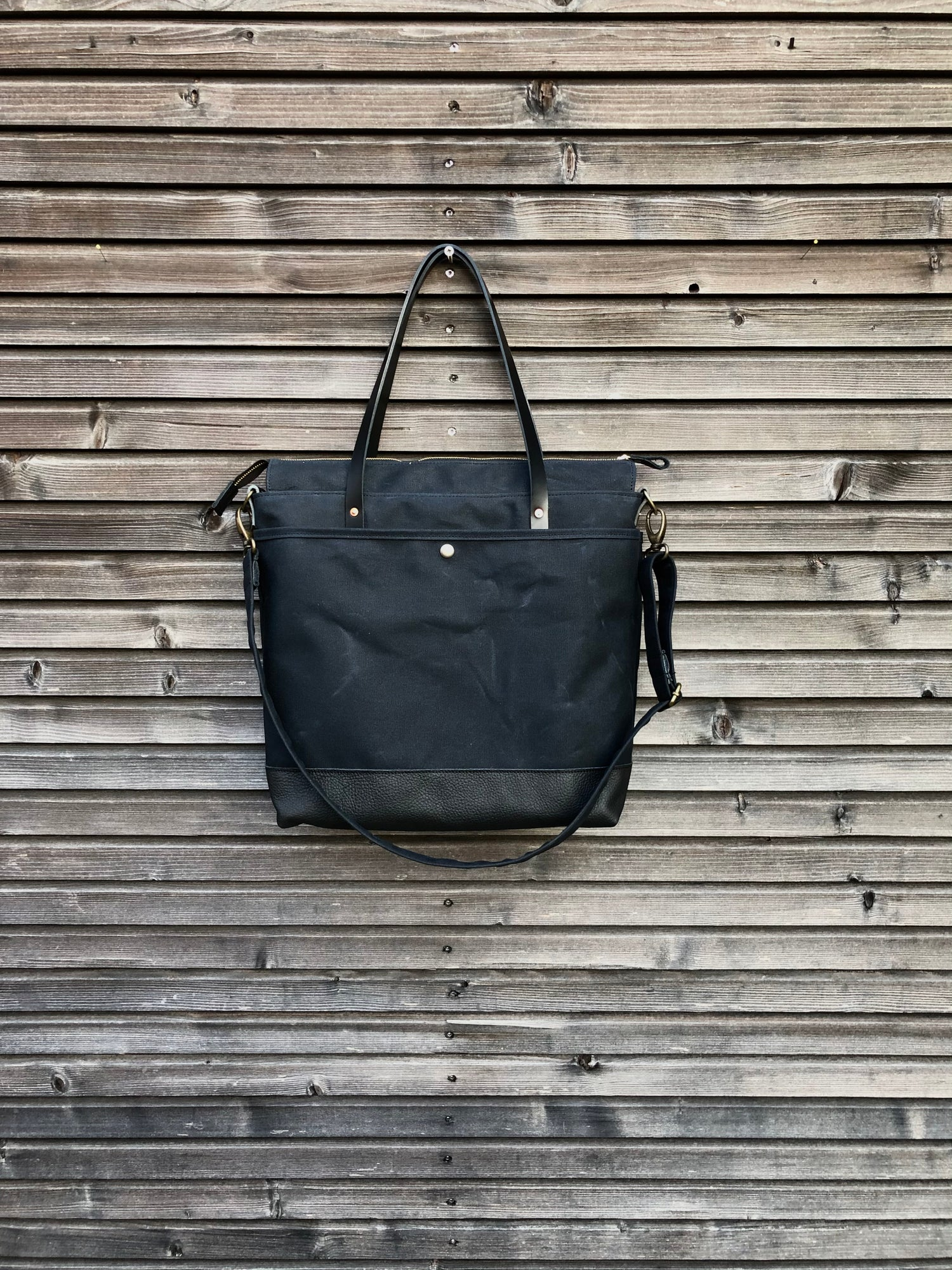 Image of Weekend bag / diaper bag in waxed canvas with leather handles and bottom COLLECTION UNISEX