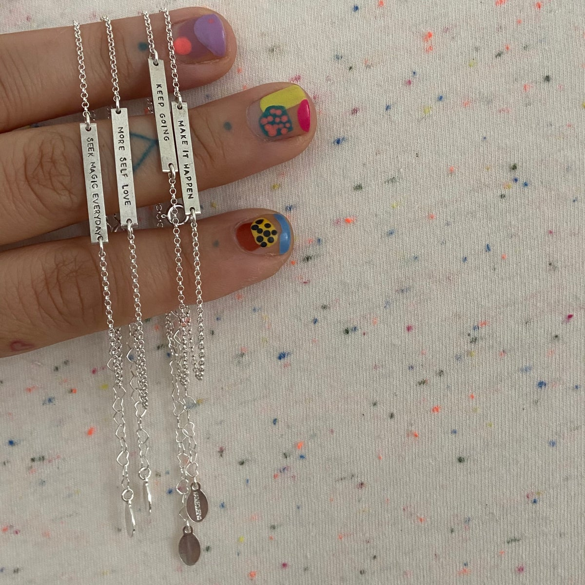 Image of bar bracelet with heart chain