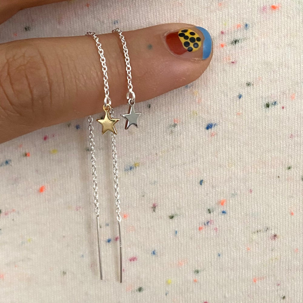 Image of single star thread earring