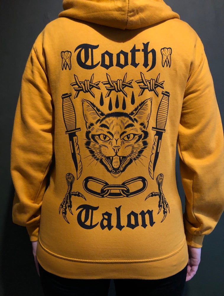 Image of  Tooth and talon zip up hoodie mustard