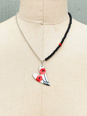 Heart with poppies on asymmetrical necklace