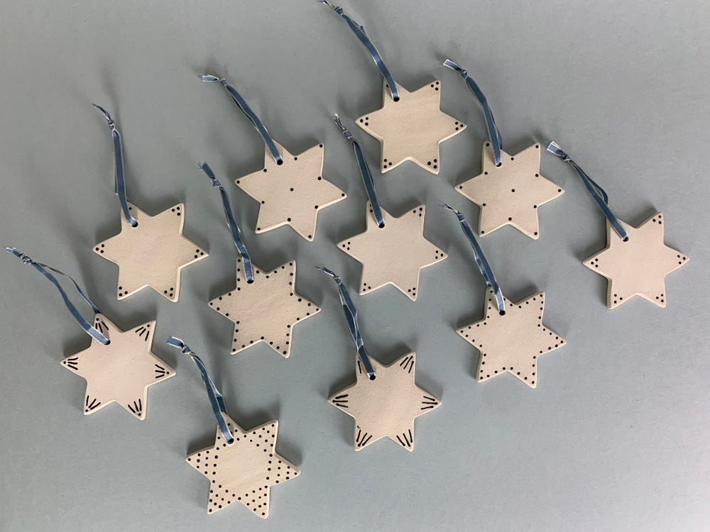Image of Christmas Star Decorations With Blue Ribbon