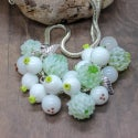 Lampwork necklace with snowberry and clover.
