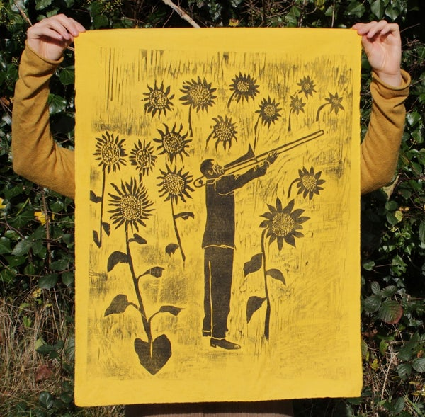 Image of Sunflower man on yellow cotton